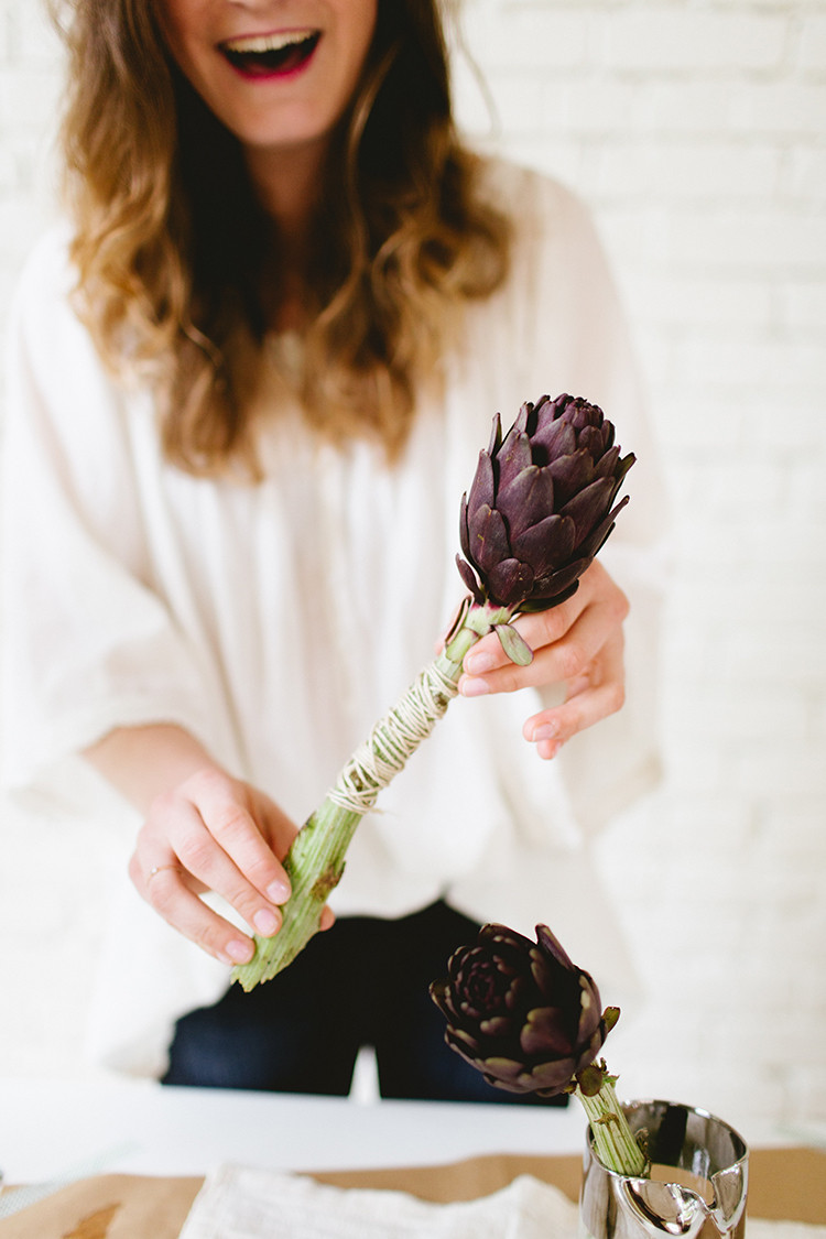 meet my new new column: shoulda been a florist! this month's spring- fresh flower arrangement uses artichokes and lilacs www.jojotastic.com photography by @meghanklein