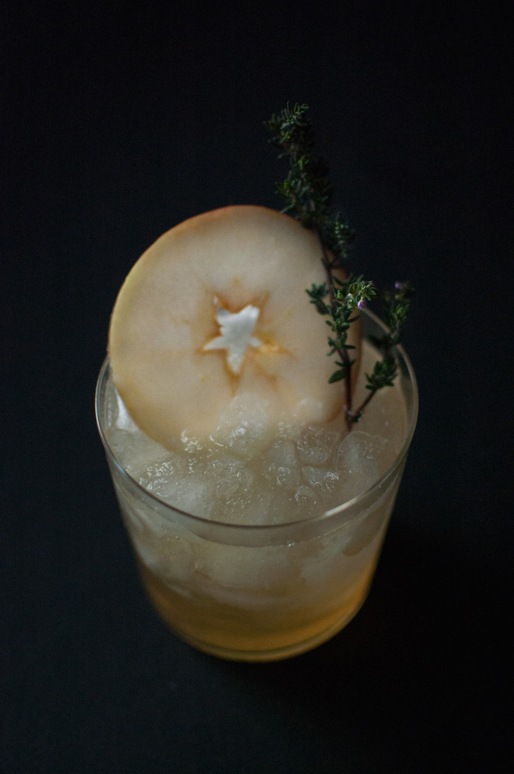portrait of a cocktail // apple + grilled thyme smash recipe on jojotastic.com