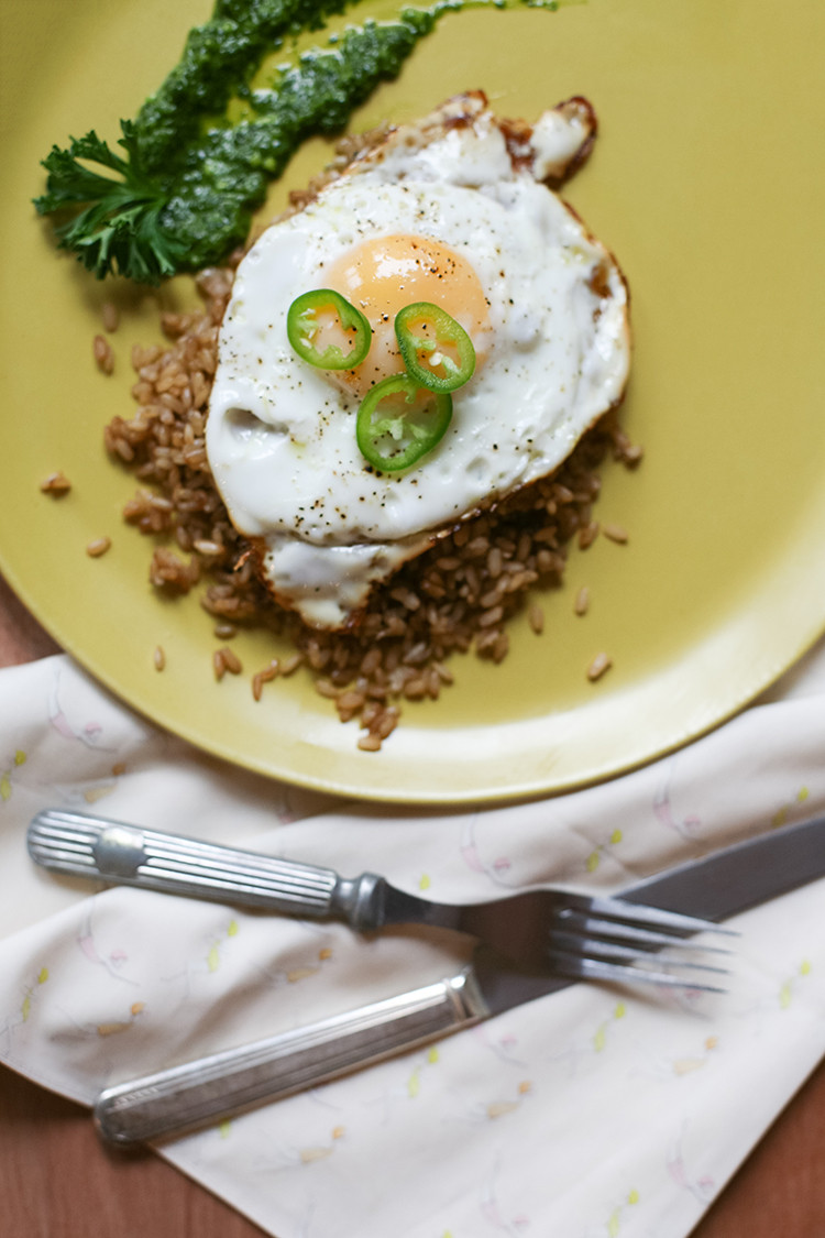 Meet your new go-to breakfast: cilantro pesto with sprouted rice pilaf, topped with a perfectly fried egg! full recipe over on jojotastic.com