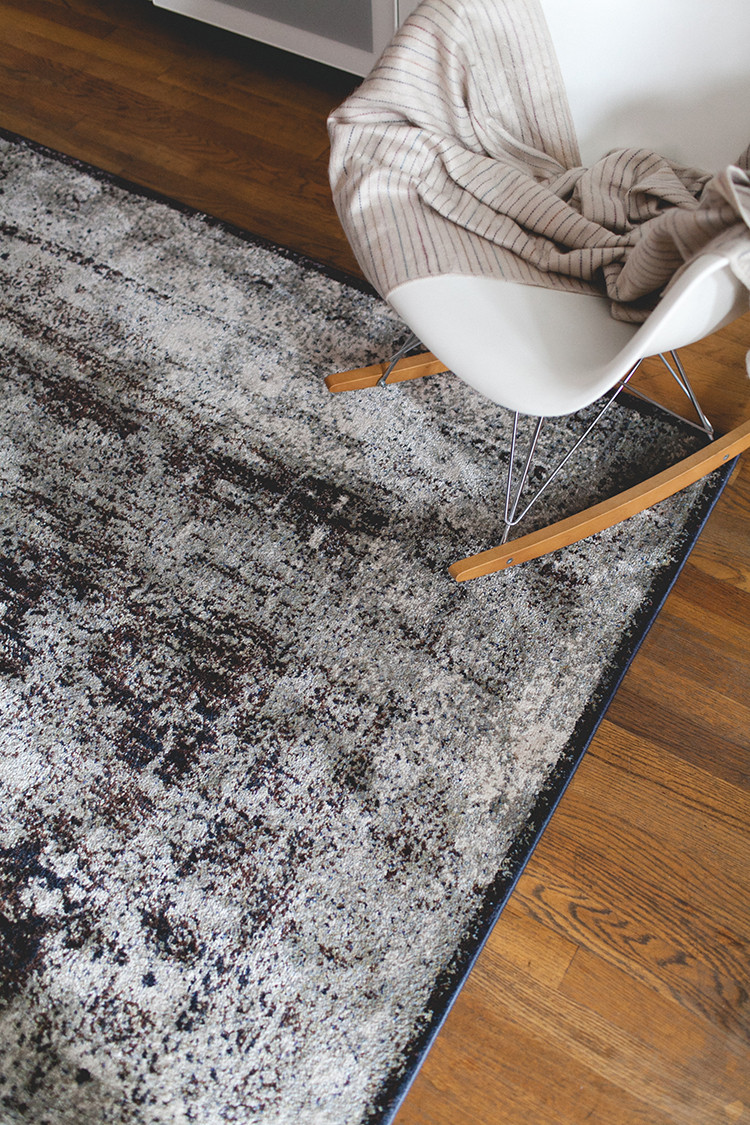 how to use rugs to define spaces in a studio apartment or loft — more home decor and styling tips on jojotastic.com