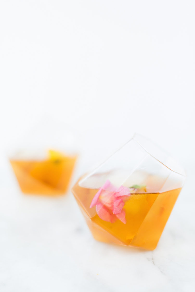 CHEERS — fancy up your favorite Old Fashioned with edible flowers! meet the Smoke and Flowers Old Fashioned and get the full recipe on jojotastic.com