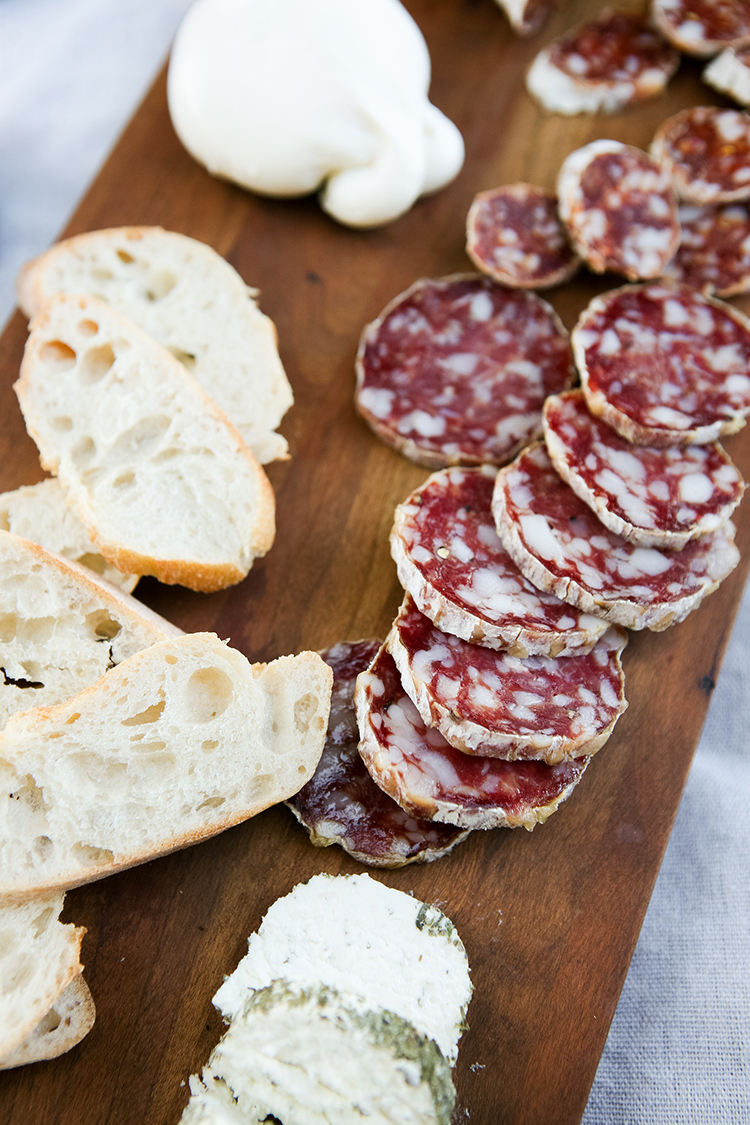 need an affordable date night idea?? how about a sunset picnic with lots of yummy @columbusmeats paired with cheeses, fruit, nuts, and more toppings! see my picnic + charcuterie essentials on jojotastic.com #salami #craftmeat #nobaloney