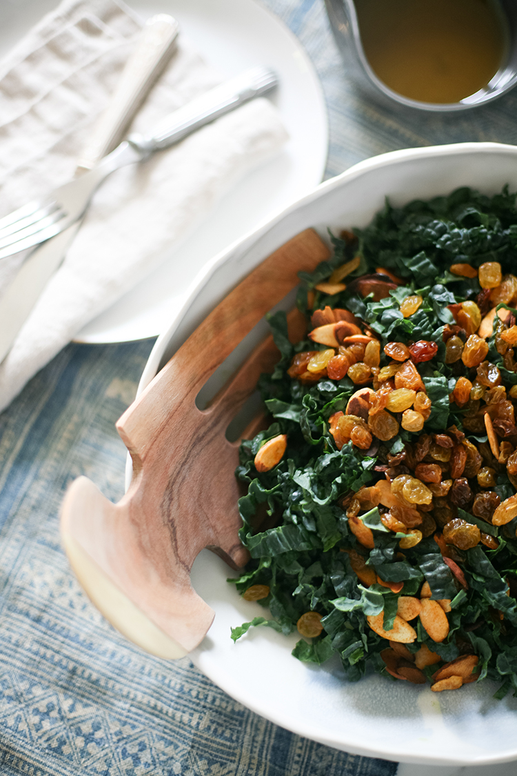 Get your salad game on point for fall with this delicious and hearty recipe! Learn how to make this golden raison + sumac kale salad on Jojotastic.com — the dressing is the perfect balance of savory and smokey flavors!