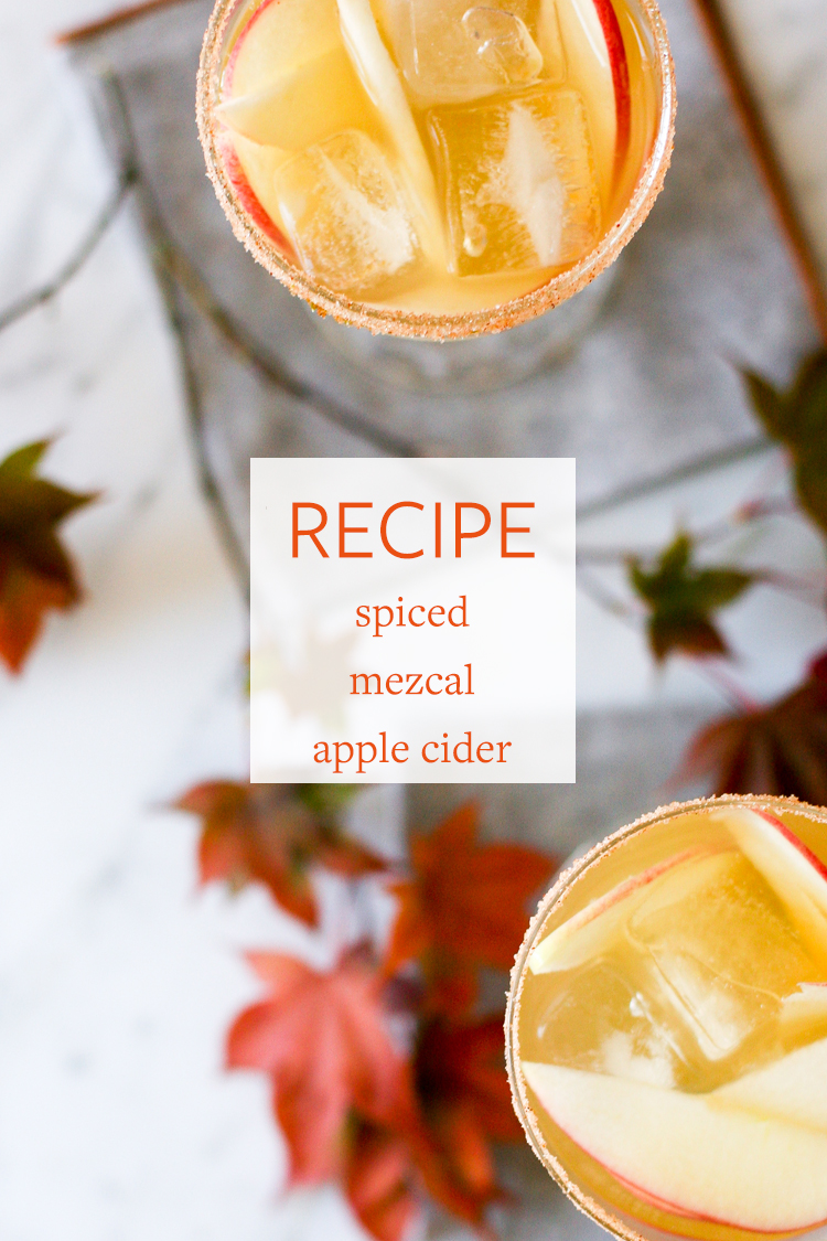 Step up your hostess game with this spicy mezcal apple cider cocktail! The recipe includes ginger beer, apples, and a dash of chili powder. Get the full recipe on Jojotastic.com + pin for later for your next party!