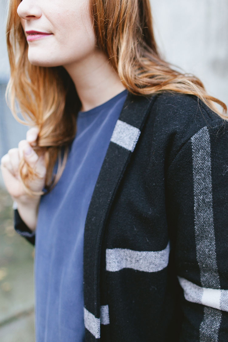 style // my layered look for Thanksgiving dinner — fashion and street style inspiration with a navy blue silk tunic top, black plaid duster coater, skinny denim jeans, vintage clogs, and black leather clutch. More style inspiration on Jojotastic.com
