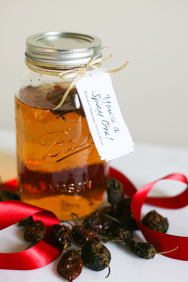 3 recipes for infused liquors: Orange + Pomegranate Infused Vodka, Habanero Infused Mezcal, and Pie Spice Infused Rum — they make a great handmade homemade gift! Get the full recipe on Jojotastic.com