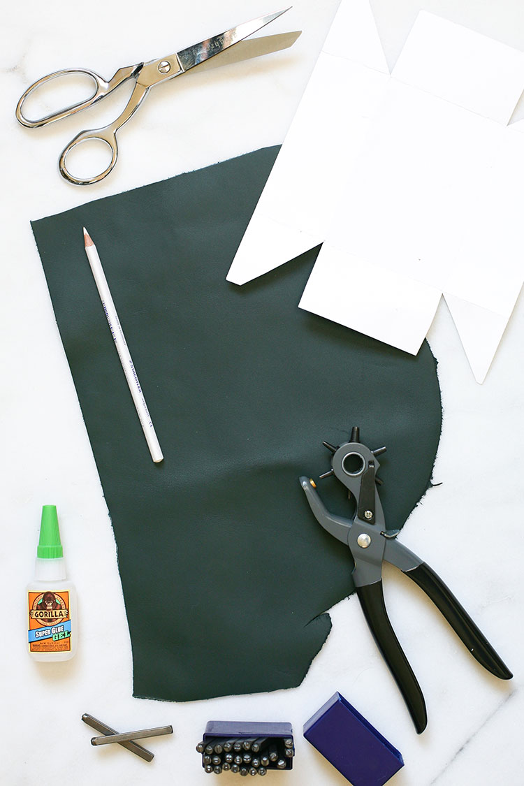 Tidy up your desk with a super easy DIY Leather Desk Organizer and Catchall! Learn how to make one from one pieces of leather at jojotastic.com