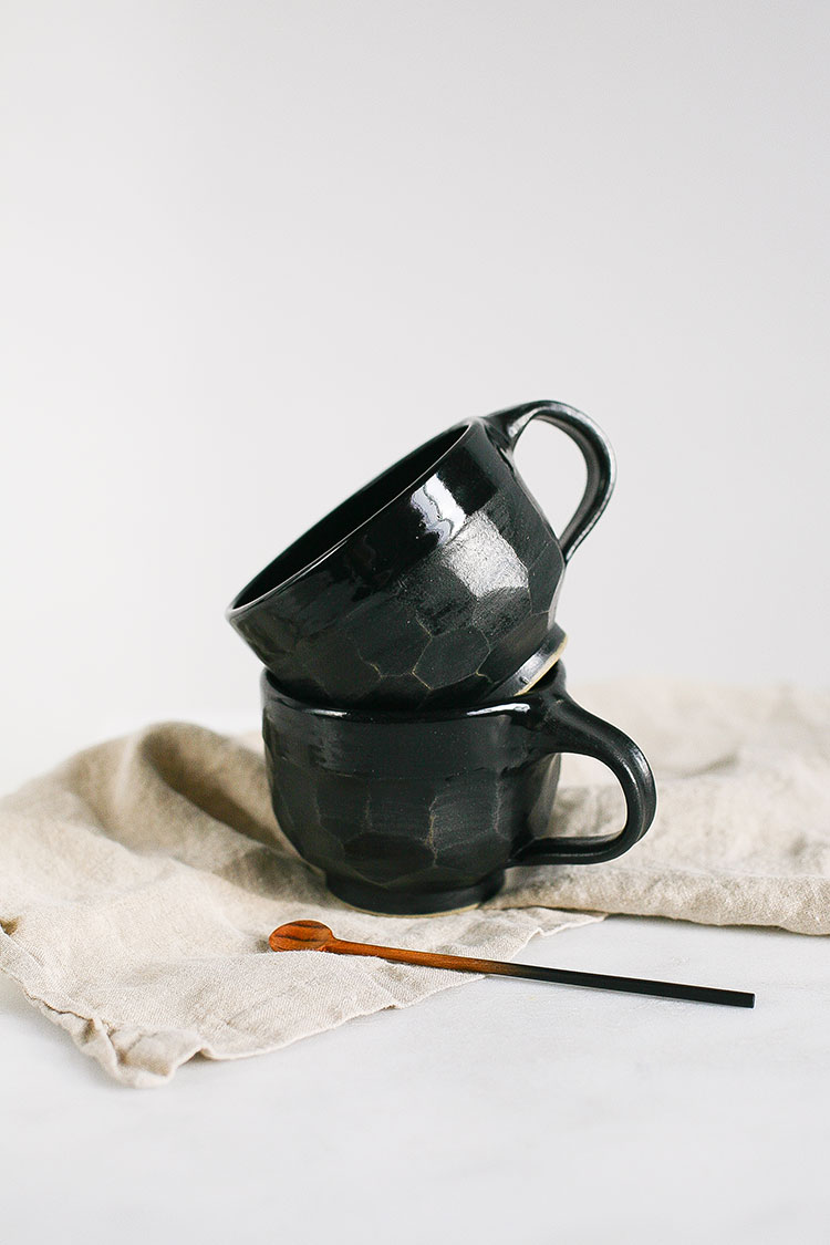 handmade ceramics from Seattle. faceted black mug. mix of glossy and matte ceramic.