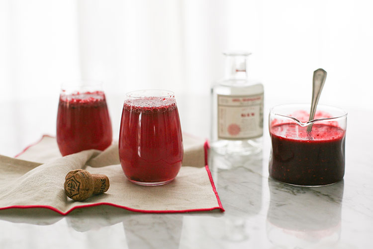 Celebrate Valentine's Day with this Blackberry French 75 cocktail recipe - made with champagne, gin, simple syrup, and pureed berries! Learn how to make this easy cocktail on Jojotastic.com
