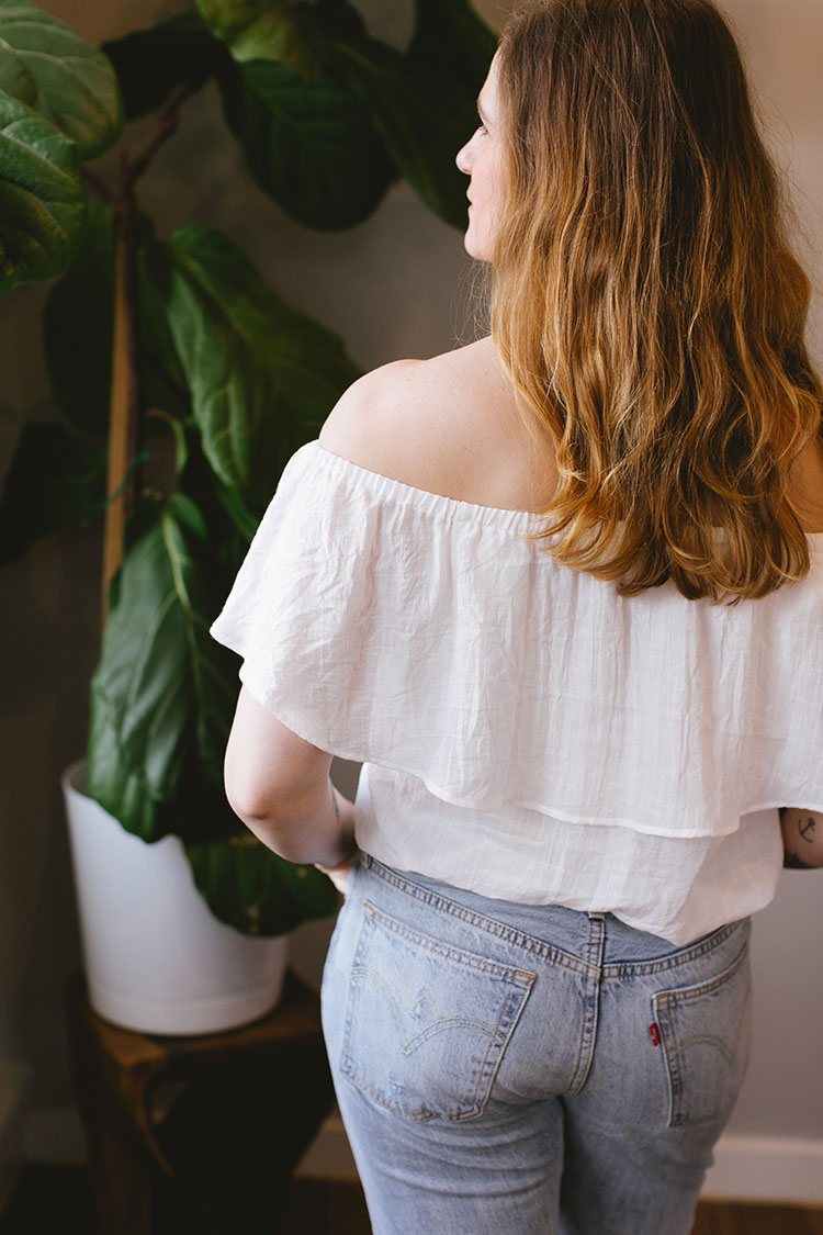 spring personal style inspiration. high-waisted levi's, white off the shoulder top, pale pink suede mules. @urbanoutfitters #uoonyou #ad