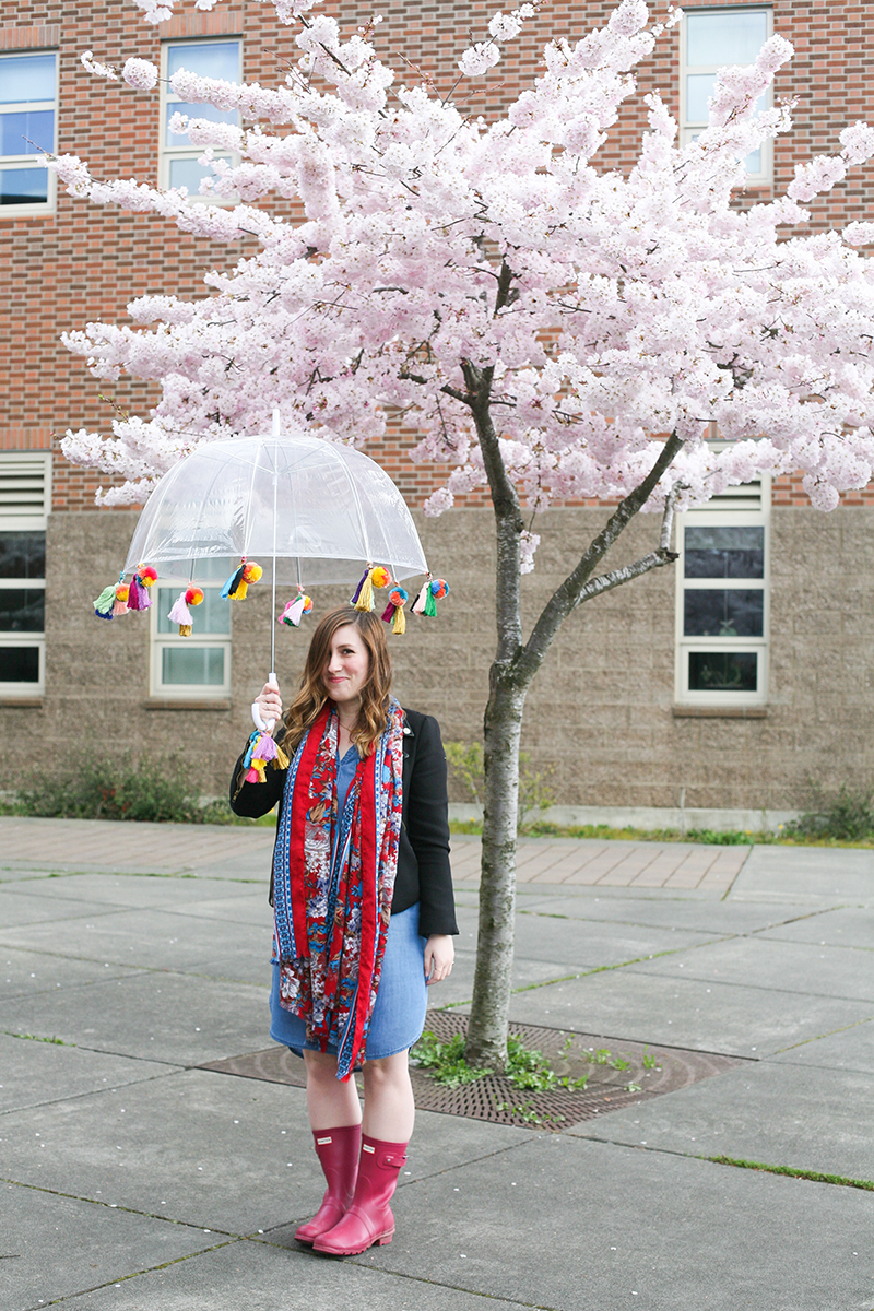 April showers bring May flowers! Prepare for those rainy days with this DIY boho pom pom and tassel clear bubble umbrella. Get the full craft tutorial on Jojotastic.com