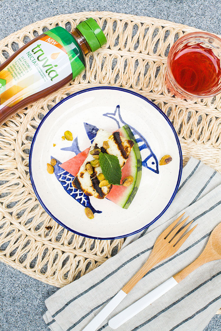 Recipe for small bite or appetizer: grilled halloumi watermelon bites with pistachios, mint and @TruviaBrand Nectar for fewer calories and twice the sweetness. Get the full recipe on Jojotastic.com #ad #TasteTruvia