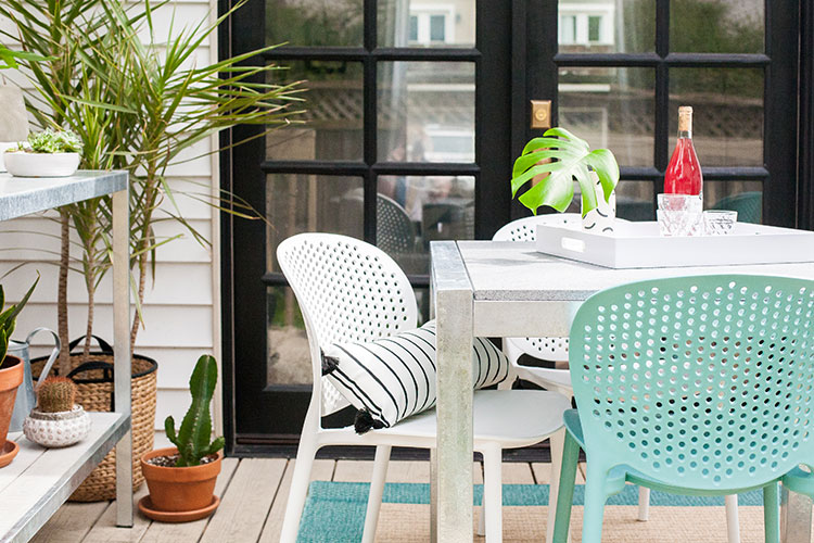 Lessons learned from a first time homeowner. Boho meets modern backyard patio and deck makeover with @Article. modern white and mint outdoor furniture. See the full reveal on jojotastic.com #Article #DotChairs #ad