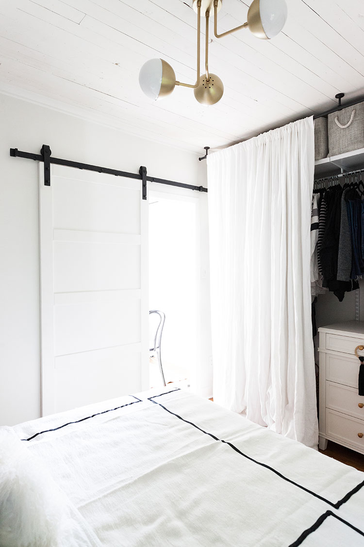 It's reveal day for my bedroom makeover and renovation! Design details include a restored shiplap ceiling, @barnandwillow custom linen drapes, @Rejuvenationinc lighting and modern barn door, and a great small space solution for a room without a closet! Get the entire source list on Jojotastic.com
