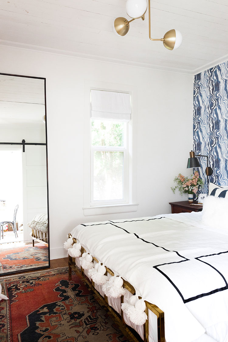 It's reveal day for my bedroom makeover and renovation! Design details include @rebecca_atwood navy blue marbled wallpaper, @potterybarn tall leaning mirror, vintage Turkish rug, @Rejuvenationinc lighting, and a great small space solution for a room without a closet! Get the entire source list on Jojotastic.com