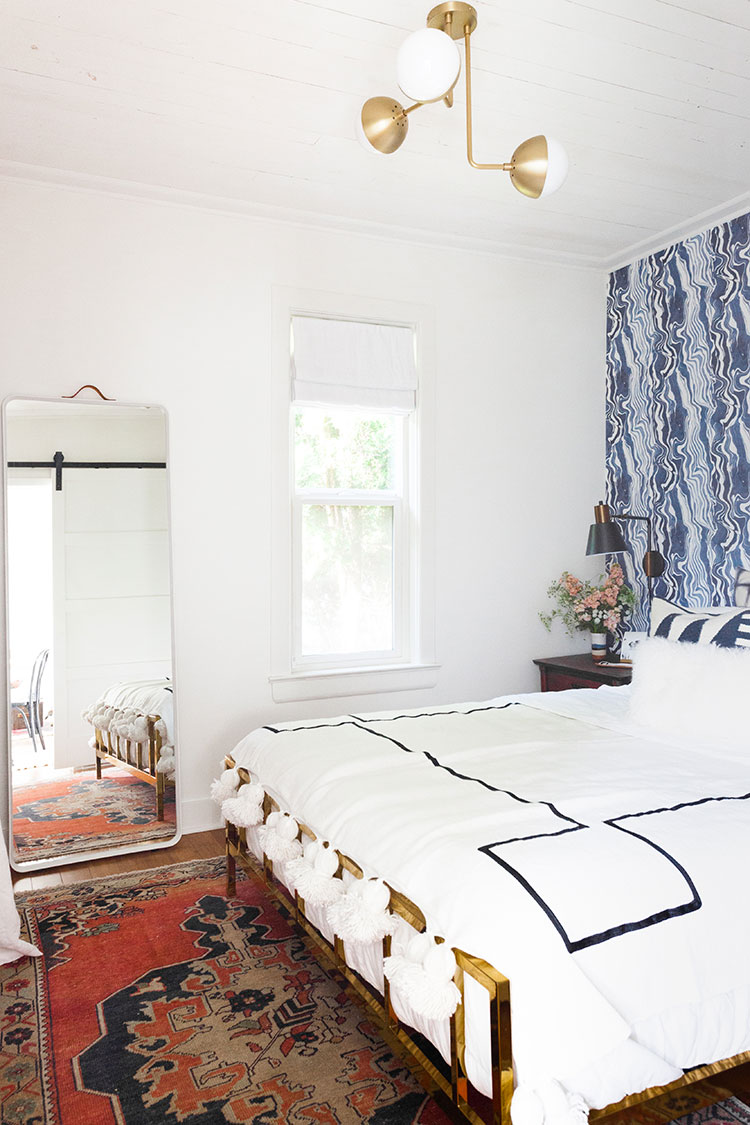 It's reveal day for my bedroom makeover and renovation! Design details include @rebecca_atwood navy blue marbled wallpaper, @allmodern tall leaning mirror, vintage Turkish rug, @Rejuvenationinc lighting, and a great small space solution for a room without a closet! Get the entire source list on Jojotastic.com