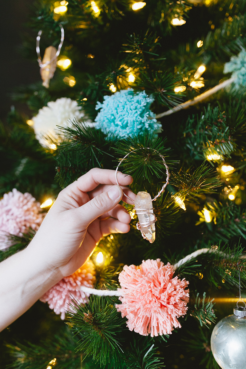 Wrap colorful crystals with wire and finish them with a dusting of gold leaf for a boho-luxe #DIY Christmas tree ornament. Get the full #holiday tutorial on jojotastic.com