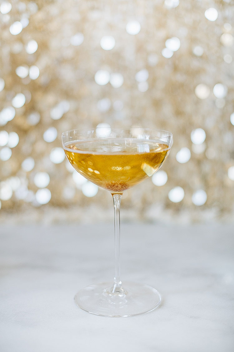 the only champagne cocktail recipe you need for NYE. made with only 3 incredients - champagne, demerera sugar cube, and grapefruit bitters. #NYE #newyearseve #champagnecocktail #cocktailrecipe