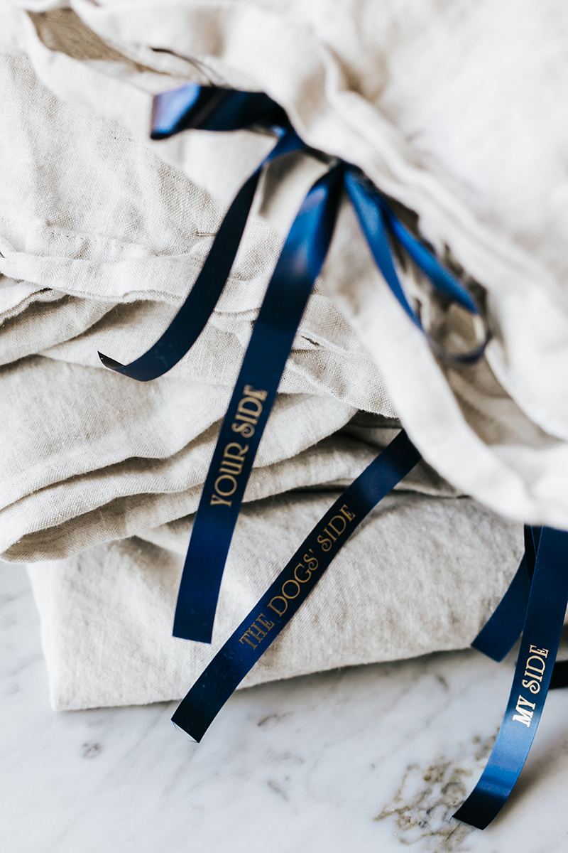 Learn how to make this beautiful, bow-tied linen duvet set with @BrotherPtouchEmbellish by printing your own customized messages on satin ribbon! on jojotastic.com #PtouchEmbellish #sponsored #diy #bedtime #springcleaning