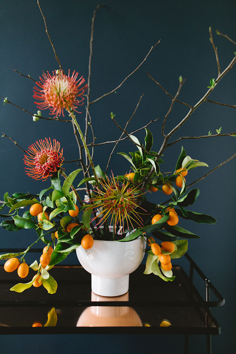 a modern springtime centerpiece with kumquats quince diy