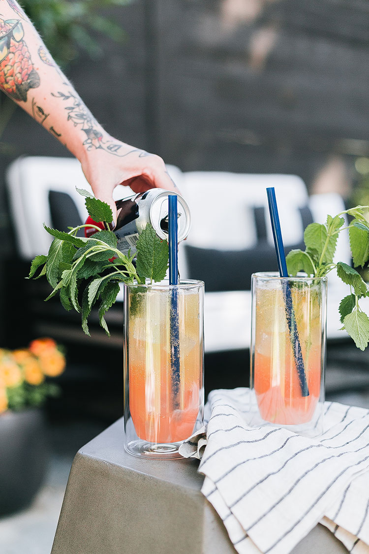 the perfect summer drink, lemon balm and grapefruit shandy recipe! perfect for entertaining on the deck or patio. #recipe #shandy #cocktail #cocktailrecipe