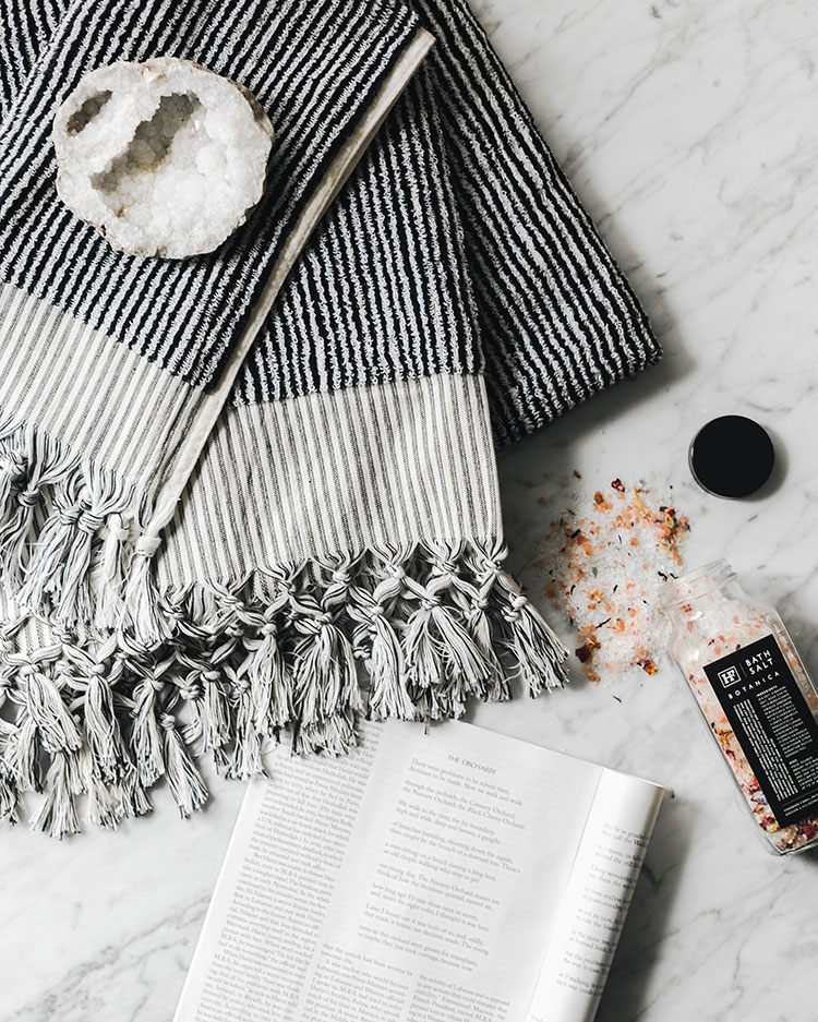 self care vibes for the weekend. black and white turkish towels, himalayan pink sea salt bath soak, and the new yorker. #flatlay #selfcare