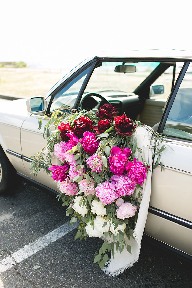Ombré Peony Floral Installation in a Vintage BMW car. DIY and craft tutorial. Tips for shopping for peonies, arrangement peonies, how to care for peonies. #vintageBMW #vintagecar #peonies #floralinstallation #wedding #getawaycar #weddingcar #peony #peonyarrangement #ombre #rainbow #pinkpeonies