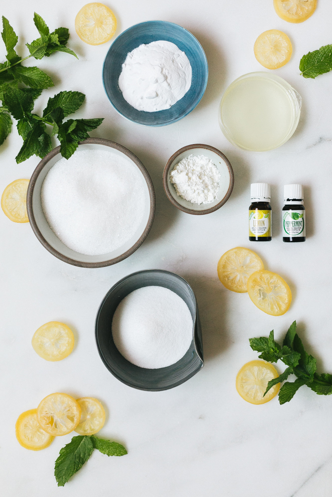 Channel the spirit and smell of summer with these mint lemonade diy bath bombs. #essentialoils #diy #summer #selfcare #homemade #bathbomb #coconutoil