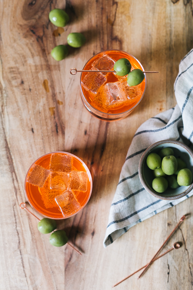 Our Twist on the Classic Negroni Recipe made with Aperol, Gin, Vermouth, Celery Bitters, and Grapefruit Bitters. Aperol Negroni aperitivo, Italian cocktail recipe. #italy #italiancocktail #aperitivo #campari #aperol #negroni #aperolnegroni