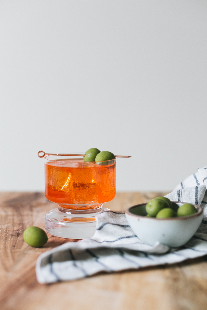 Our Twist on the Classic Negroni Recipe made with Aperol, Gin, Vermouth, Celery Bitters, and Grapefruit Bitters. Aperol Negroni aperitivo, Italian cocktail recipe. #italy #campari #aperol #negroni #aperolnegroni