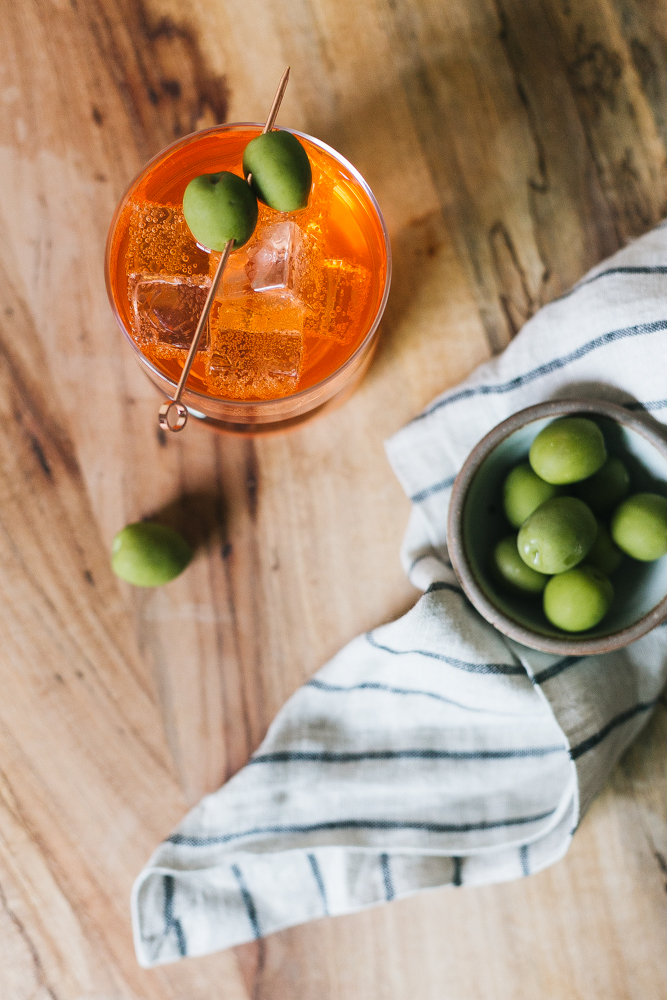 Our Twist on the Classic Negroni Recipe made with Aperol, Gin, Vermouth, Celery Bitters, and Grapefruit Bitters. Aperol Negroni aperitivo, Italian cocktail recipe.  #italiancocktail #aperitivo #campari #aperol #negroni #aperolnegroni