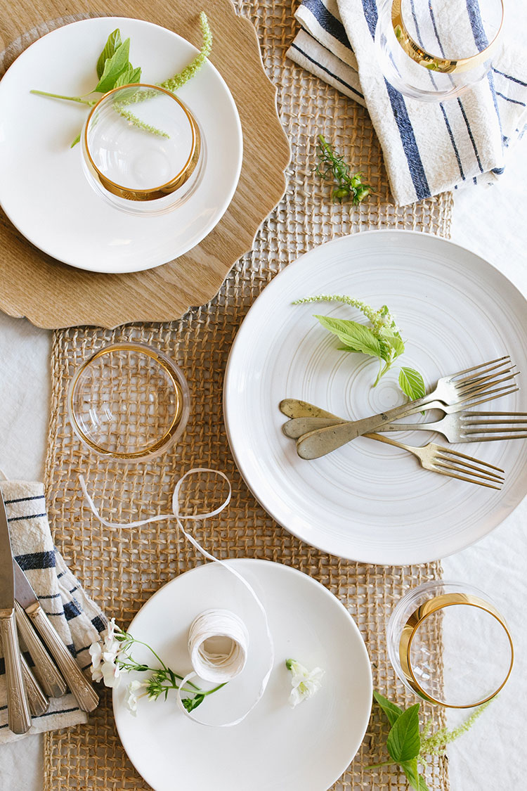 Small Space Entertaining, A Summer-Inspired Brunch Tablescape with layered white plates, wooden chargers, raw rough linen, vintage flatware utensils, and gold rimmed glasses. #tablescape #tabletop #entertaining #smallspaces #hostess