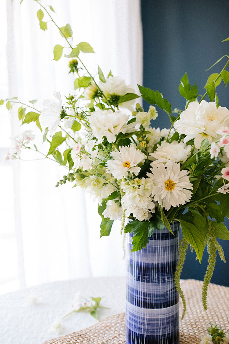 An All-White Floral Centerpiece Inspired by Summer DIY. flower bouquet made with White Dahlias, White Double Cosmos, Bittersweet Vine, White Snapdragon, Trailing Amaranth, Blushing Bride Phlox, and Green Nine-bark. #floralarrangement #florals #flowers #flowerarrangement #centerpiece #allwhite #whiteflowers  #summer