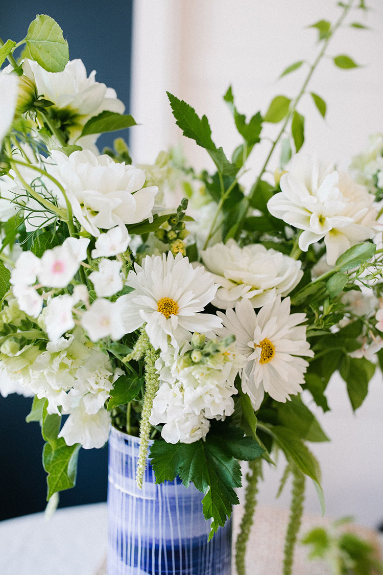 An All-White Floral Centerpiece Inspired by Summer DIY. flower bouquet made with White Dahlias, White Double Cosmos, Bittersweet Vine, White Snapdragon, Trailing Amaranth, Blushing Bride Phlox, and Green Nine-bark. #floralarrangement #florals #flowers #flowerarrangement #allwhite #whiteflowers #dahlias #summer