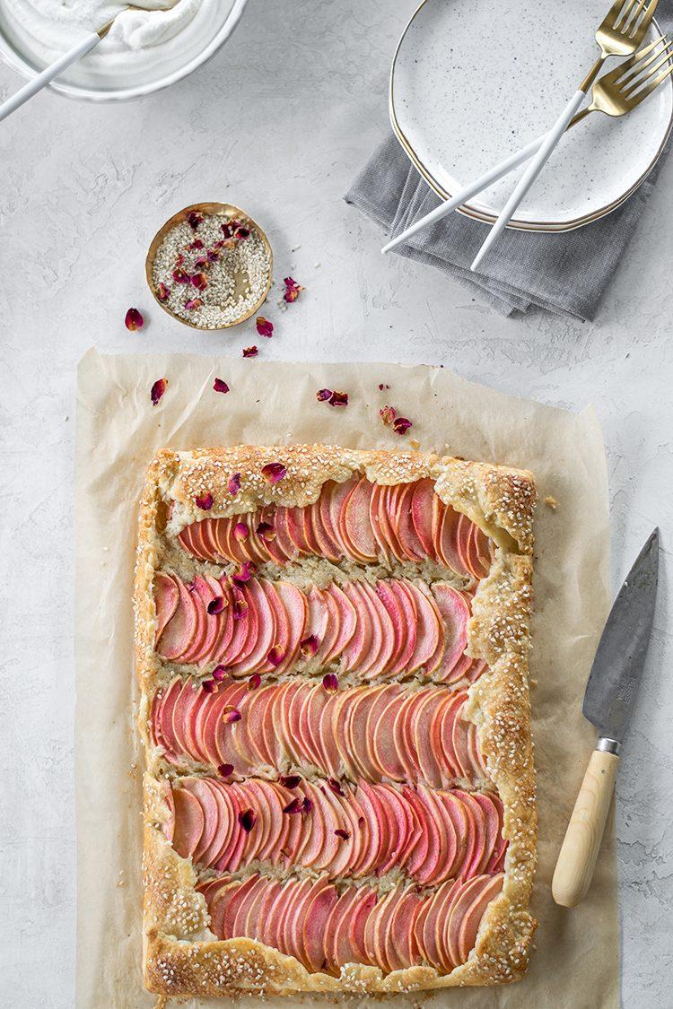 Tahini Frangipane Apple Galette with Salted Honey Rose Cream recipe for breakfast, brunch, or dessert. #tahini #frangipane #apple #applegalette #galette #recipe #brunch #rosewater #saltedhoney #pinksalt