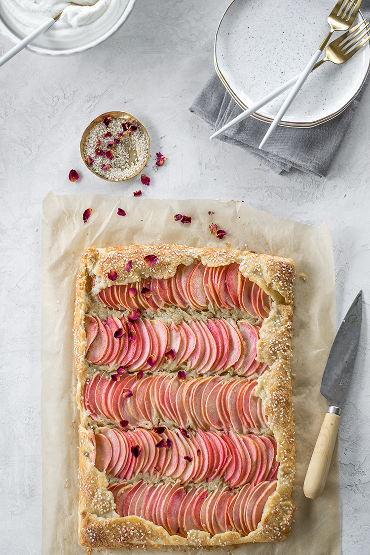 Tahini Frangipane Apple Galette with Salted Honey Rose Cream recipe for breakfast, brunch, or dessert. #tahini #frangipane #apple #applegalette #galette #recipe #brunch #rosewater #saltedhoney #pinksalt