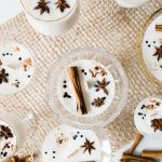 Upcycle old barware and turn it into eggnog-scented candles made with soy wax for the holidays. Get the full soy wax candle DIY tutorial at Jojotastic.com #diy #holiday #candle #eggnog #essentialoils #cinnamon #staranise #nutmeg #soycandle