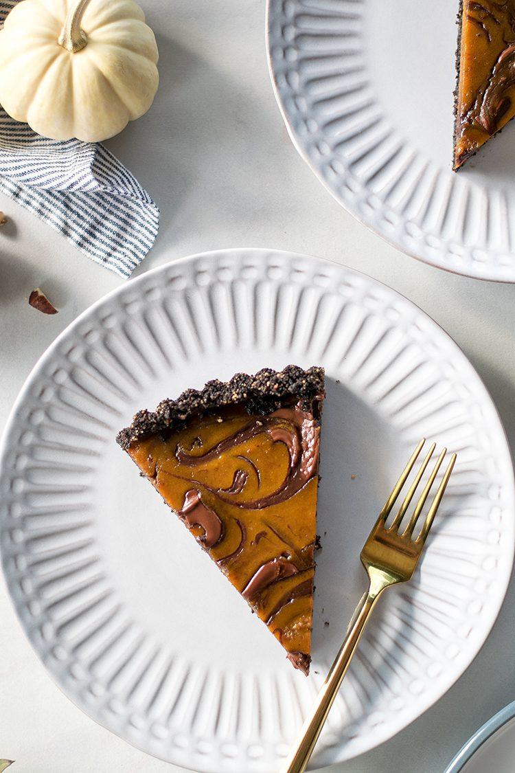 Pumpkin Nutella Swirl Tart recipe for dessert, Halloween, or Thanksgiving. #pumpkin #nutella #swirl #tart #hazelnut #chocolate #pumpkintart #pumpkinpie #thanksgiving #halloween #fall #swirltart #marbled