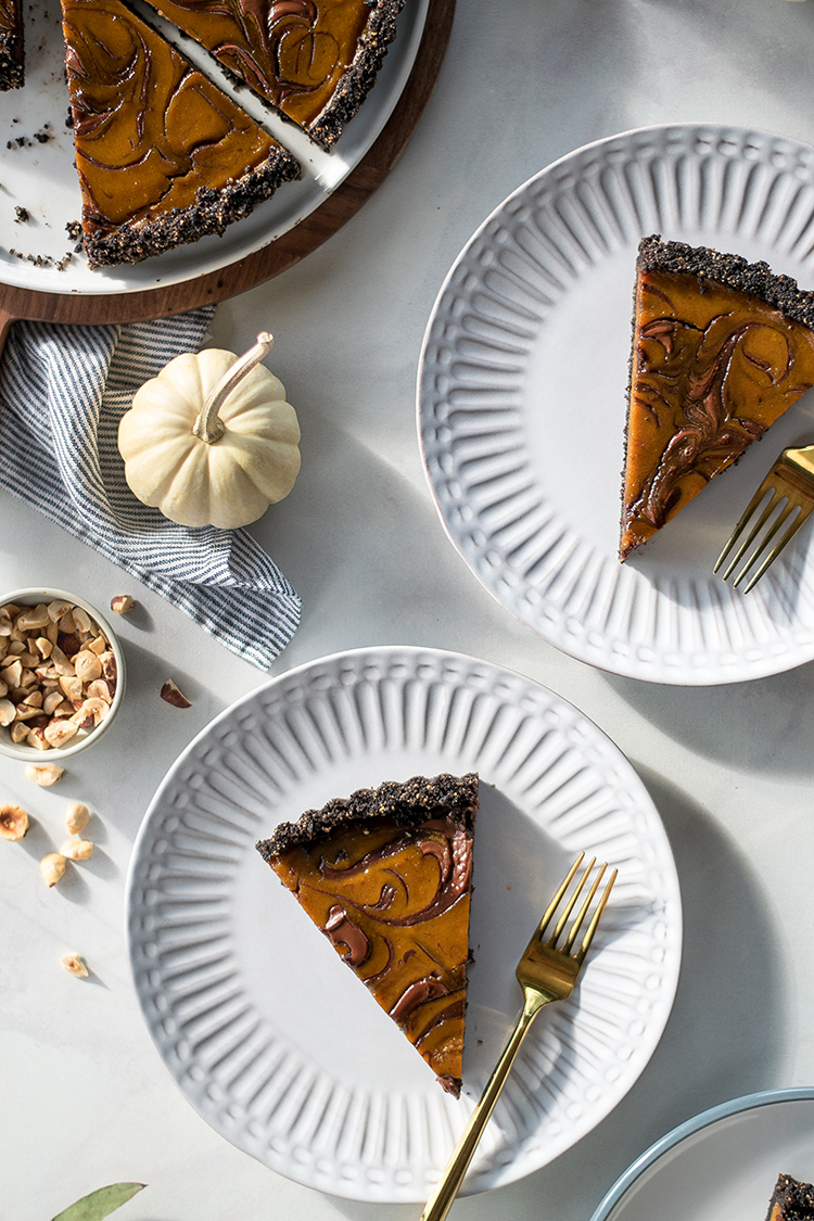 Pumpkin Nutella Swirl Tart recipe for dessert, Halloween, or Thanksgiving. #pumpkin #nutella #swirl #tart #hazelnut #chocolate #pumpkintart #pumpkinpie #thanksgiving #halloween #fall #swirltart #marbled