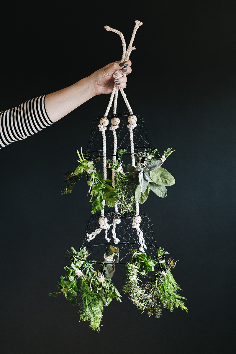 Save your fresh herbs for a rainy day by hanging them to dry on this DIY herb drying rack. Get the full tutorial at Jojotastic.com #diy #herbs #kitchen