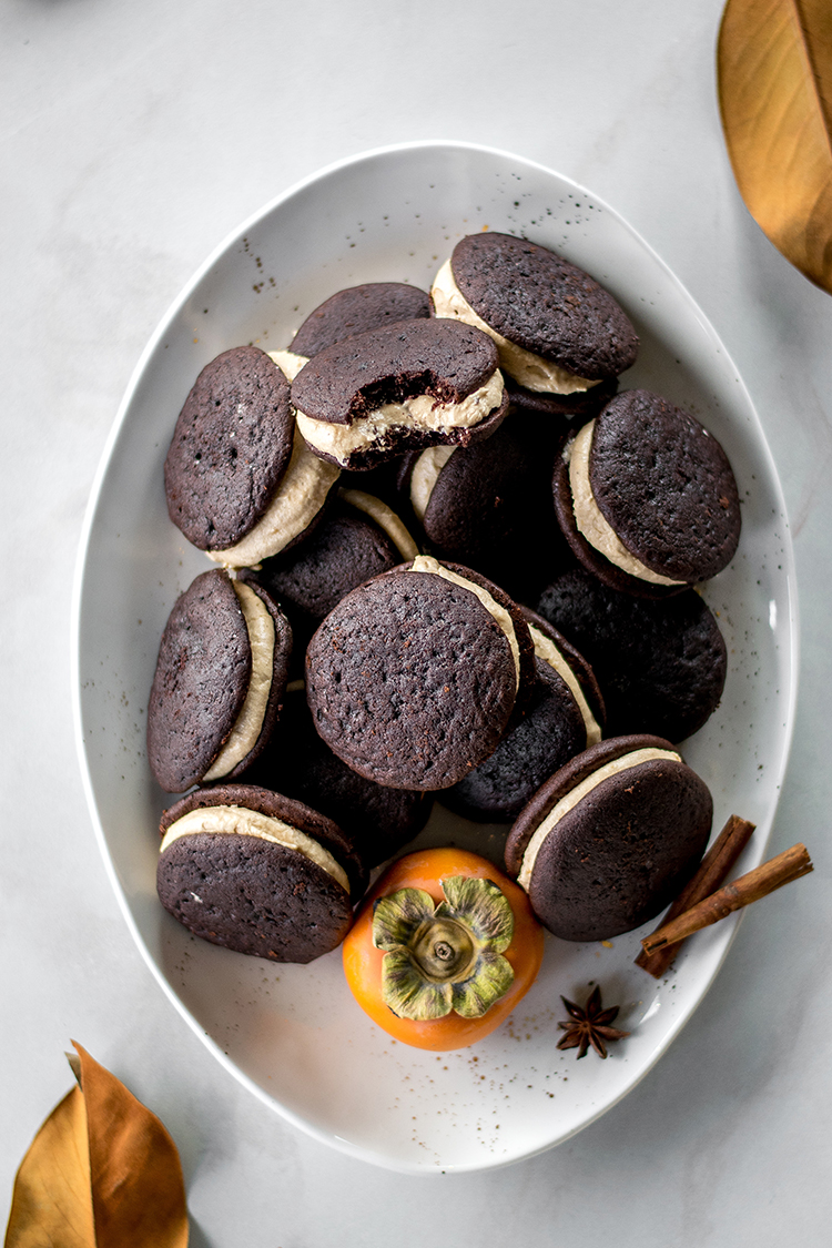 Spiced Persimmon Dark Chocolate Whoopie Pies recipe for Fall, Thanksgiving dessert, or snack. #recipe #whoopiepies #persimmon #spiced #thanksgiving #halloween #fall #autumn #dessert #sweet #cake #snack #chocolate #darkchocolate