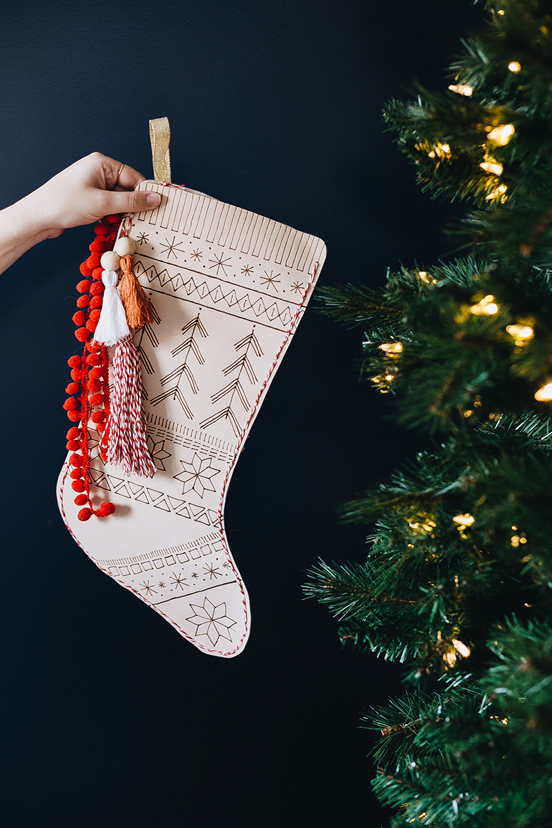 A classic Fair Isle pattern is burned into the leather of this stocking, making for a chic holiday decoration. Get the full tutorial at Jojotastic.com #DIY #holiday #stocking