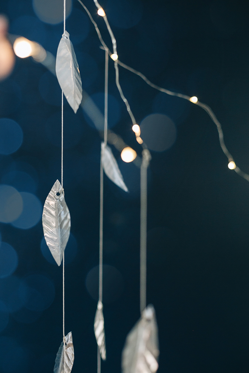 A DIY metal leaf garland with twinkle lights is perfect for adding cheer to your house, for the holidays and beyond! Get the full tutorial at Jojotastic.com #garland #holiday #DIY