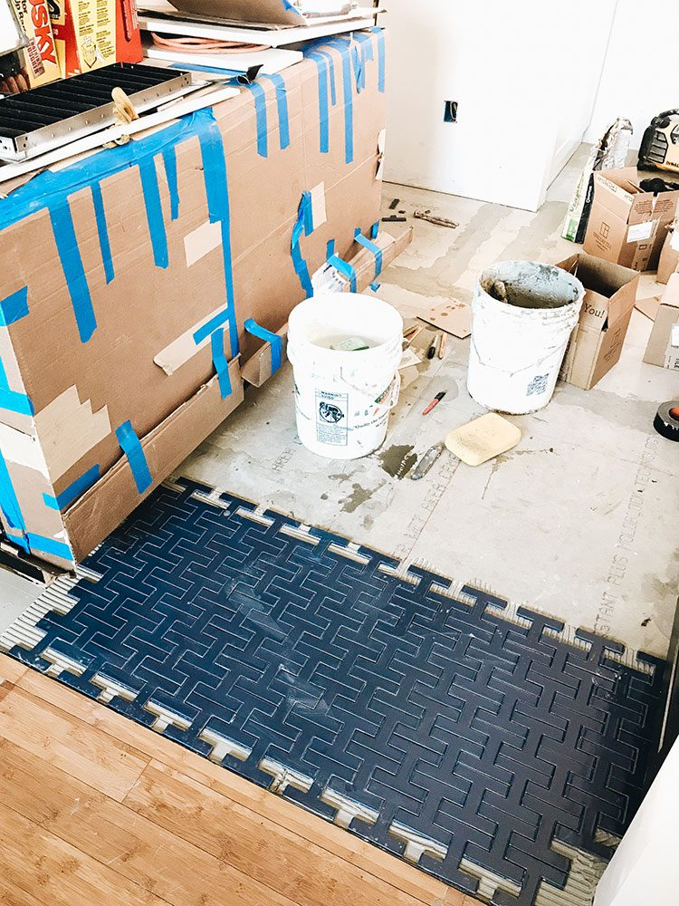 Our Kitchen Renovation: Progress Report #3. Installation of Chaine Homme tile by @FireclayTile. update about our small kitchen remodel including cabinets, floor tiles, countertops, faucet finish, hardware, lighting. Designed by interior designer and expert @roomfortuesday#oldhouse #kitchen #kitchenrenovation #demoday #renovation #oldhome #oldhomerenovation #smallspaces #smallkitchen #kitchenrenovation #beforeafter #kitchenmakeover #kitchen #makeover #fixerupper #fireclay #fireclaytile #chainehomme #tileinstallation