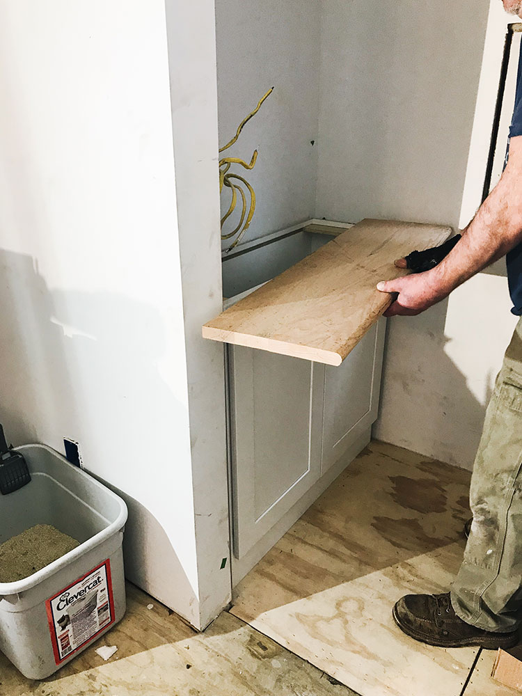 Our Kitchen Renovation: Progress Report #2. update about our small kitchen remodel including cabinets, floor tiles, countertops, faucet finish, hardware, lighting. Designed by interior designer and expert @roomfortuesday with @fireclaytile @rejuvenationinc @kitchenaidusa @masterbrandcabinetsinc @deltafaucet @polycordesign @sinkology #oldhouse #kitchen #kitchenrenovation #demoday #renovation #oldhome #oldhomerenovation #smallspaces #smallkitchen #kitchenrenovation #beforeafter #kitchenmakeover #kitchen #makeover #fixerupper