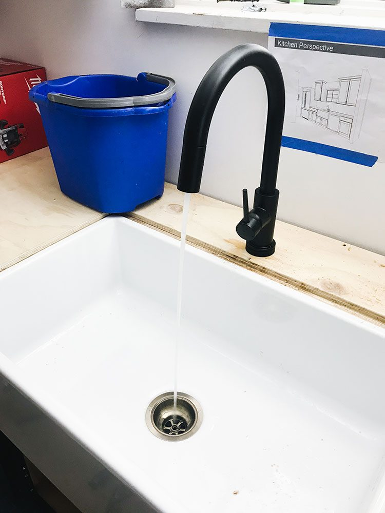 Our Kitchen Renovation: New Farmhouse Sink & Running Water! Small kitchen remodel including cabinets, floor tiles, countertops, faucet finish, hardware, lighting. Designed by interior designer @roomfortuesday w/ @fireclaytile @rejuvenationinc @kitchenaidusa @masterbrandcabinetsinc @deltafaucet @polycordesign @sinkology #ad #oldhouse #kitchen #kitchenrenovation #demoday #renovation #oldhome #oldhomerenovation #smallspaces #smallkitchen #kitchenrenovation #beforeafter #kitchenmakeover #kitchen #makeover #fixerupper