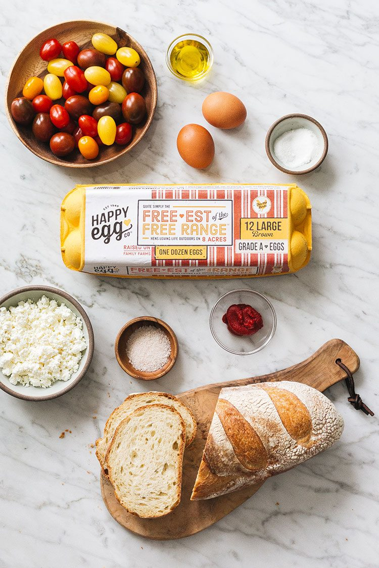 My Family's Strapatsada Recipe (Easy Greek Scrambled Eggs) made with the Happy Egg Co. Free-est of the Free Range Eggs available at @safeway. Combine @happyeggcousa eggs, tomatoes, fresh oregano, tomato paste, and feta for a delicious breakfast or snack. #ad #strapatsada #greekrecipe #greekfood #greekbreakfast #scrambledeggs #freerangeeggs #breakfastrecipe