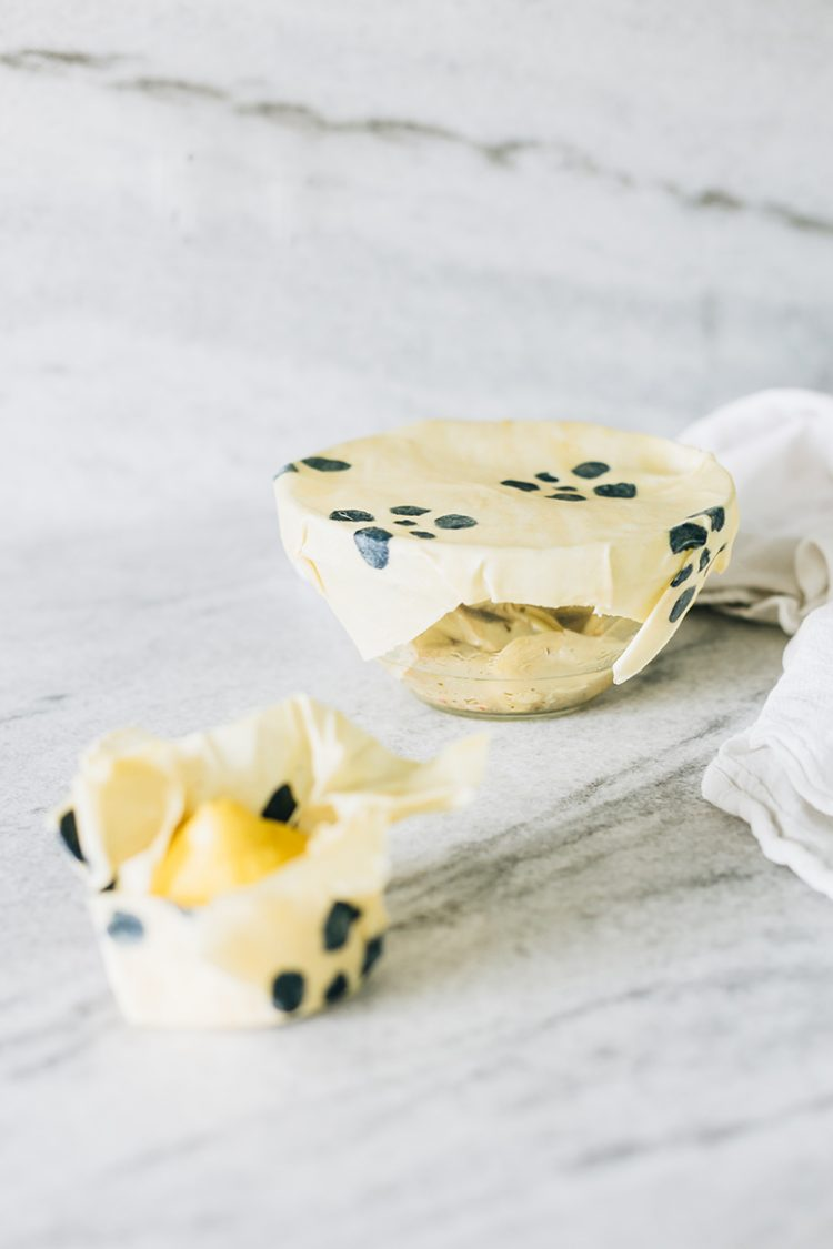 How To Make Reusable Beeswax Wraps — Perfect for Zero Waste Food Storage! DIY tutorial. A bit of fabric paint and some beeswax transform a piece of cotton into reusable, sustainable food wraps. Get the full tutorial at Jojotastic.com #DIY #foodwraps #sustainability #beeswaxwrap #beeswax #zerowaste #cleanliving #zerowastliving #livegreen #eco #wellness #noplastic #reducewaste