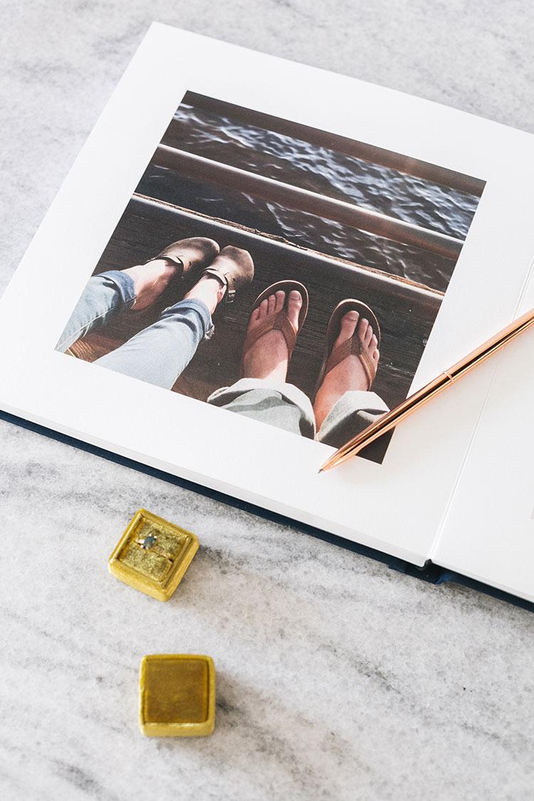 Check Out Our Wedding Guest Book From Artifact Uprising! Plus, learn all about the new partnership with Zola. @artifactuprsng #wedding #weddingplanning #nontraditionalwedding #modernwedding #weddingstationery #letterpress #goldfoil #weddinginvitation #enclosurecard #bluewedding #navywedding #goldwedding #guestbook #weddingguestbook