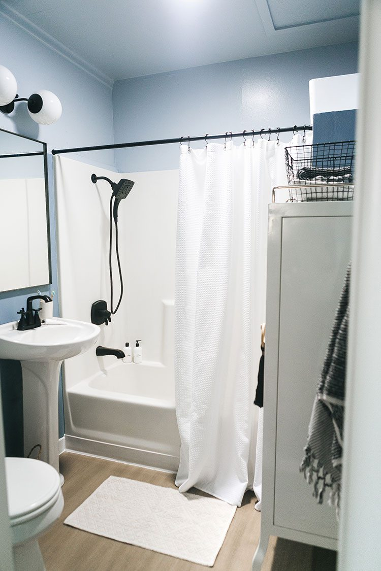 Our Tiny Bathroom Makeover with Colorblocked Walls & Ceiling! Learn all about EasyCare Ultra Premium Paint from @truevalue, a low-odor and low-VOC paint and primer in one. #ad #EasyCarePaint #bathroommakeover #minimakeover #bathroomrefresh #tinybathroom #smallbathroom #colorblock #bluebathroom #frenchblue #colorblocking #colorblocked